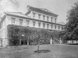 historical black and white photo of a large building