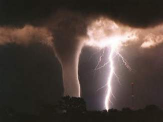 photo of lightning and a tornado funnel