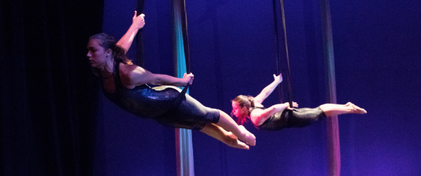Dancers perform an aerial dance on silks during the Dance Performance Sampler, part of the Spotlight on the Arts Festival.