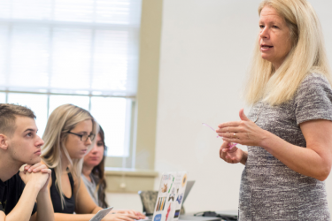 SPIA Professor Susan Haire teaching her research methods during a criminal justice class in one of the classrooms in Candler Hall.