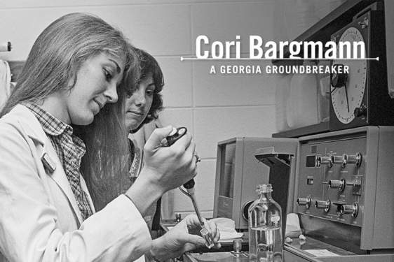 black and white photo of two people in a lab, woman in foreground