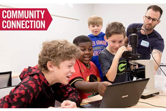 photo of kids with microscope and computer