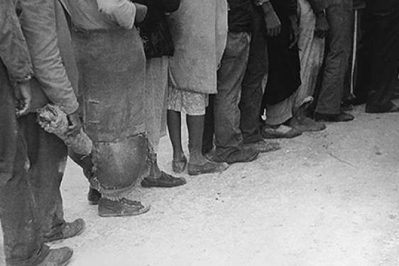 black and white photo of people standing in line