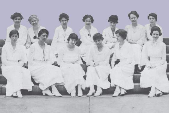 historical photo of women seated on steps
