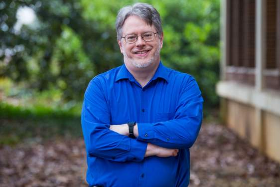 photo of man in blue shirt, outdoors
