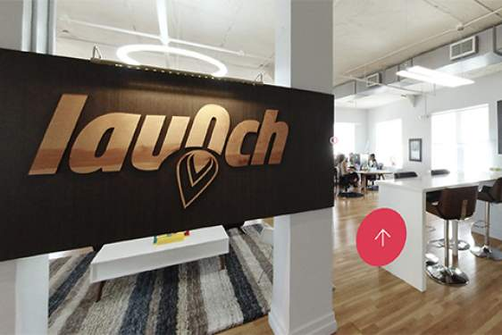 inside of an office space, with sign 'Launch'
