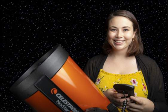 photo of woman with telescope and starry background