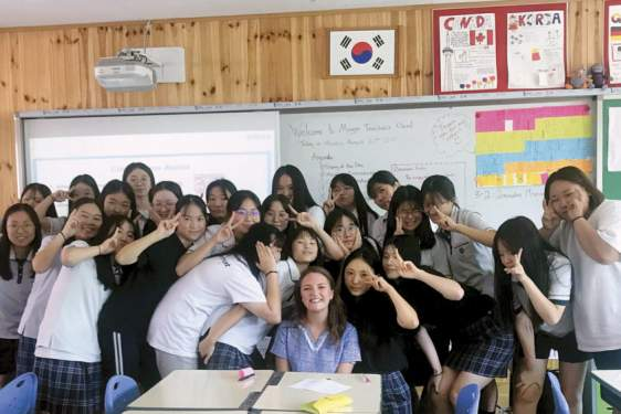 photo of woman with students in classroom
