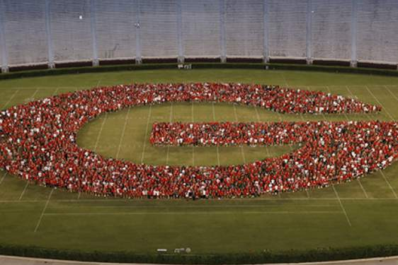 photo of students forming a G on the stadium field