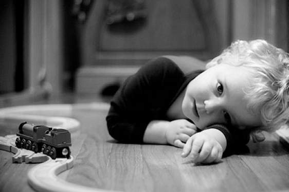 child in b/w with trains