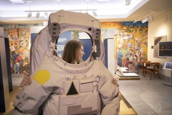 photo of woman with astronaut suit