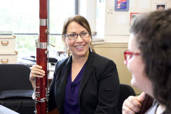 photo of woman with bassoon, and student
